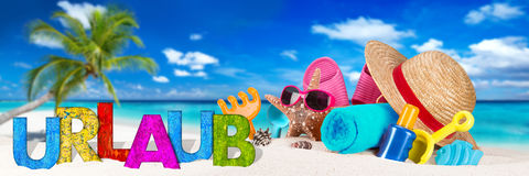 Urlaub / vacation accessory on tropical paradise beach Royalty Free Stock Images