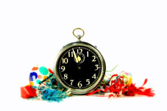 Urlaubsparty-Weinlese Tin Noise Makers And Big Ben Alarm Clock Stockbild