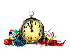 Urlaubsparty-Weinlese Tin Noise Makers And Big Ben Alarm Clock Lizenzfreies Stockbild
