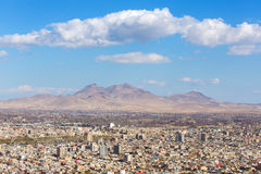 Urmia city aerial view with mountains, Iran Stock Images