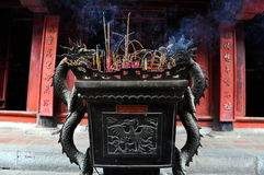 Urn in Buddhist temple filled with incense stick, Hanoi, Vietnam Royalty Free Stock Photos