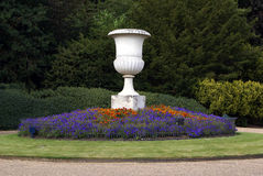 Urn and flower bed in a park or a garden Royalty Free Stock Image