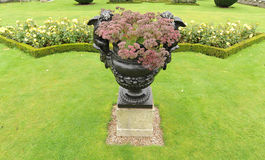 Urn in garden Royalty Free Stock Photo