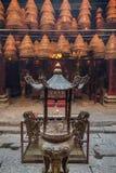 Urn and incense cones at the Man Mo Temple in Tai Po, Hong Kong. Stock Photos