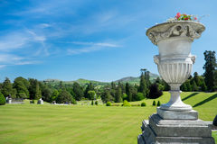 Urn planter. Urn statue filled with flowers at Powerscourt estate Stock Images