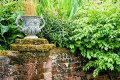 Urn on top of a wall Stock Images