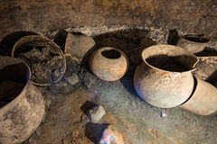Urns in underground grave Royalty Free Stock Image