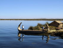 Uro boys on a boat, the Uros floating islands Royalty Free Stock Images