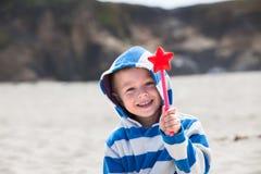 Urocza berbeć chłopiec z magiczną różdżką w jego ręce Fotografia Royalty Free