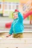 Urocza chłopiec bawić się przy boiskiem Zdjęcie Royalty Free