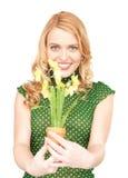 Urocza gospodyni domowa z kwiatem Fotografia Stock