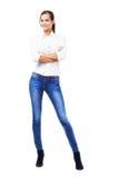 Urocza kobieta w białych niebieskich dżinsach i koszula Obraz Stock