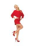 Urocza kobieta w czerwieni sukni na szpilkach Fotografia Stock