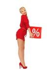 Urocza kobieta w czerwieni sukni z procentu znakiem Obraz Stock