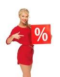 Urocza kobieta w czerwieni sukni z procentu znakiem Obraz Royalty Free