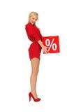 Urocza kobieta w czerwieni sukni z procentu znakiem Zdjęcie Stock