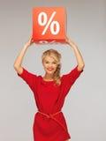 Urocza kobieta w czerwieni sukni z procentu znakiem Obrazy Royalty Free