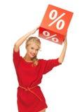 Urocza kobieta w czerwieni sukni z procentu znakiem Obrazy Stock
