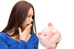 Urocza kobieta z prosiątko bankiem Zdjęcia Stock