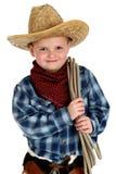 Urocza młoda chłopiec jest ubranym kowbojskiego kapeluszu mienia arkanę Fotografia Stock
