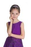Urocza mała dziewczynka przeciw bielowi fotografia stock
