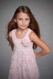 Urocza mała dziewczynka z bieżącym włosy obrazy stock