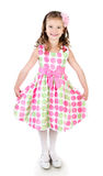 Urocza uśmiechnięta mała dziewczynka w różowej princess sukni fotografia royalty free