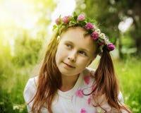 Urocza zadumana dziewczyna w wianku kwiaty Obrazy Stock