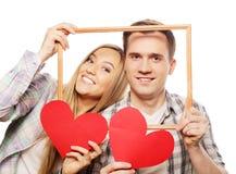 Uroczego pary mienia ramowi i czerwoni serca Obraz Stock