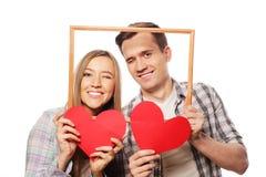 Uroczego pary mienia ramowi i czerwoni serca Fotografia Royalty Free
