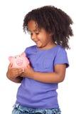 uroczej afrykańskiej banka dziewczyny mały prosiątko obrazy stock