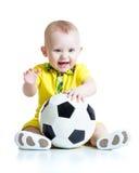 Uroczy dzieciak z futbolem nad białym tłem Zdjęcia Royalty Free