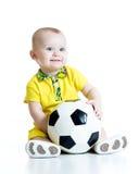 Uroczy dzieciak z futbolem nad białym tłem Fotografia Royalty Free
