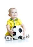 Uroczy dzieciak z futbolem nad białym tłem Fotografia Stock