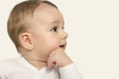 Uroczy dziecko portret z ręką w usta Obraz Royalty Free