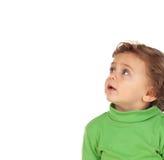 Uroczy dziecko z zielony koszulowy przyglądający up Obraz Stock