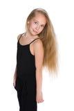 Uroczy młoda dziewczyna stojaki zdjęcia stock