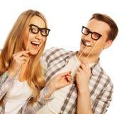 Uroczy pary mienia przyjęcia szkła na kiju Zdjęcie Stock