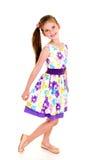 Uroczy uśmiechnięty małej dziewczynki dziecko w princess sukni odizolowywającej obrazy stock