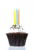 Urodzinowa babeczka z świeczką odizolowywa Zdjęcia Stock