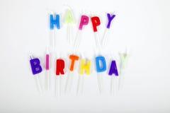 Urodzinowe świeczki przeciw białemu tłu Fotografia Royalty Free