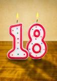 Urodzinowe świeczki liczba 18 Zdjęcia Stock
