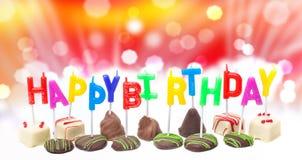 Urodzinowe świeczki przeciw bokeh Fotografia Royalty Free