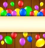 Urodzinowy tło z balonami i miejsce dla teksta na drewnianym tle Obraz Stock