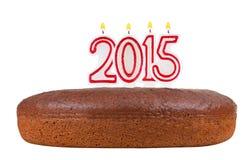 Urodzinowy tort z świeczkami liczba 2015 odizolowywająca Obraz Royalty Free