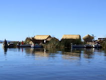 The Uros floating island with boats Royalty Free Stock Photo