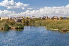 Uros floating island and village on Lake Titicaca near Puno,  Peru Royalty Free Stock Photography
