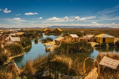 The Uros island from a boat on the Titicaca Lake, Peru royalty free stock photo