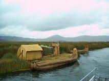 UROS ISLAND - LAKE TITICACA - PERU, January 3, 2007: Uros reed boat along floating island on Lake Titicaca, Peru. Uros reed boat along floating island on Lake Stock Photo