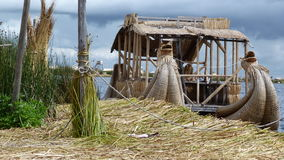 Uros Islands in Bolivia. Uros floating island in Bolivia with boats made of reeds Stock Image